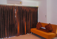 Fully air-conditioned condominium with individual temperature control and complete blind-out curtains in Pattaya Thailand.