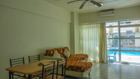 Living Room of condominium for rent in Niran Condo, fully furnished with sofa, dining table and much more.