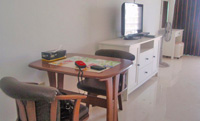 Beachfront condominium for rent in Pattaya with Flat screen TV and working desk.