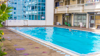 Pattaya condo for rent with large outdoor swimming pool. Simply step out of your apartment to the pool in Nirun Grand Ville.